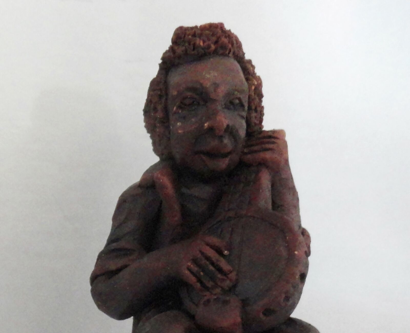 Musician Playing Banjo Red Clay Figurine