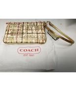 COACH CREAM WITH GOLD TARTAN SMALL WRISTLET  - $19.80