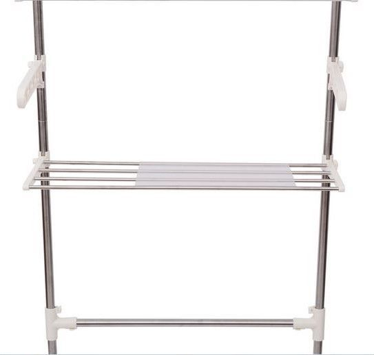 metal bathroom cabinet organizer shelf bath towel rack hanging over