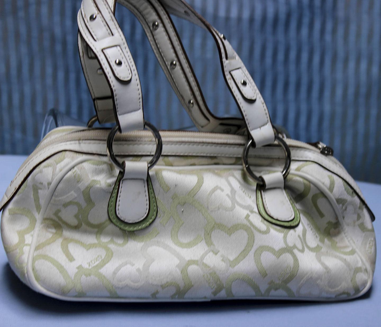 XOXO green and white purse