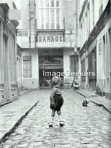 5 x 7 Baby Child alone garage France 1934 photo reprint - $4.99