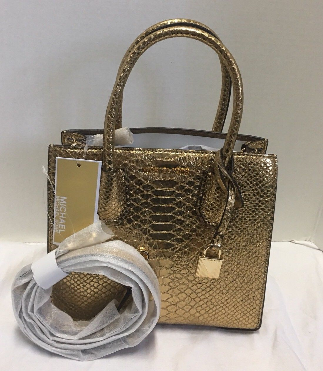 d0ae2c7b009783 S l1600. S l1600. Previous. MICHAEL KORS STUDIO Mercer Metallic Medium  Messenger Gold Crossbody Tote NWT