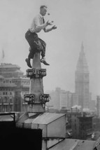 Reynolds Juggles balls on the Pinnacle of a roof high above New York City - Art  - $19.99+