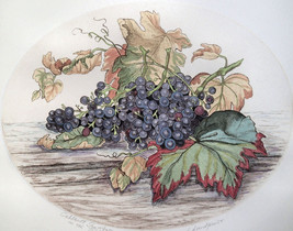 Dorothy Lundquist Cabernet Sauvignonon grapes on wood table Oval etching... - $19.79