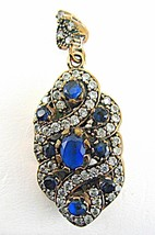 Faceted Blue Sapphire encrusted White Topaz Ste... - $137.00
