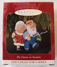 1997 Clauses on Vacation Hallmark Ornament - $3.91