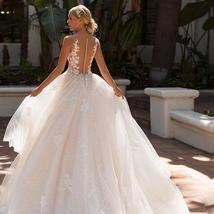 Elegant Applique Cap Deep V Scoop A Line Lace Luxury Bridal Gown image 2