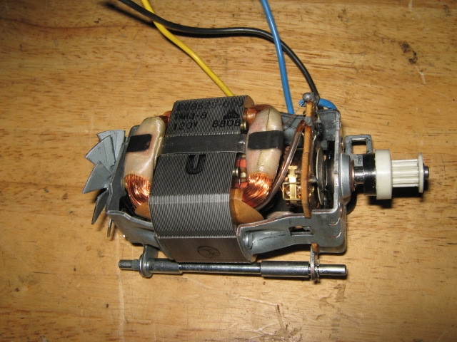 how to open sewing machine motor