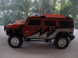 HUMMER 2003 orange H2 with lights and sounds BATTERY OPERATED - $9.89