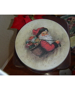 Christmas Tin Features Santa with a Basket of Toys - $8.00