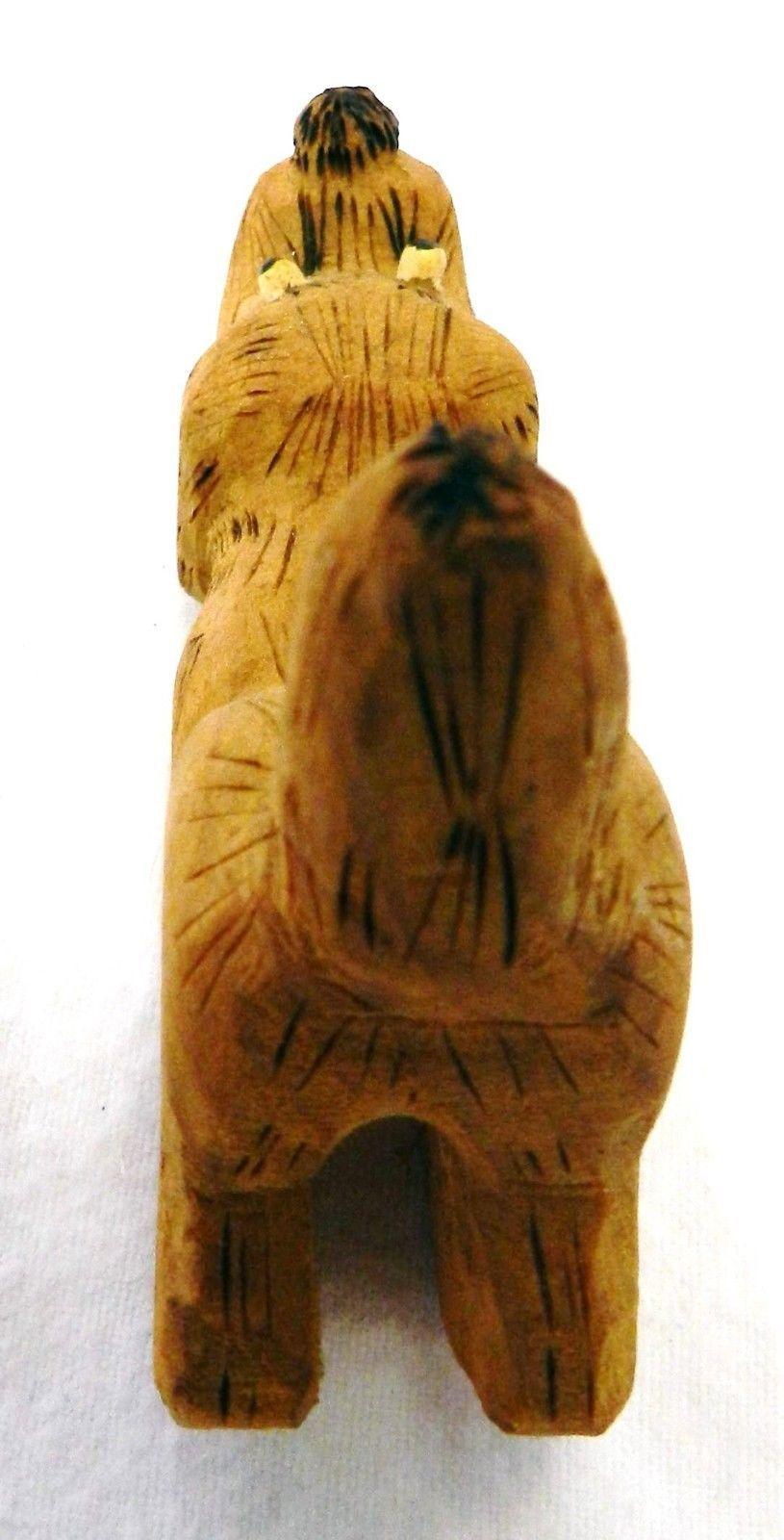 Vintage hand carved wood wooden dog sniffing ground