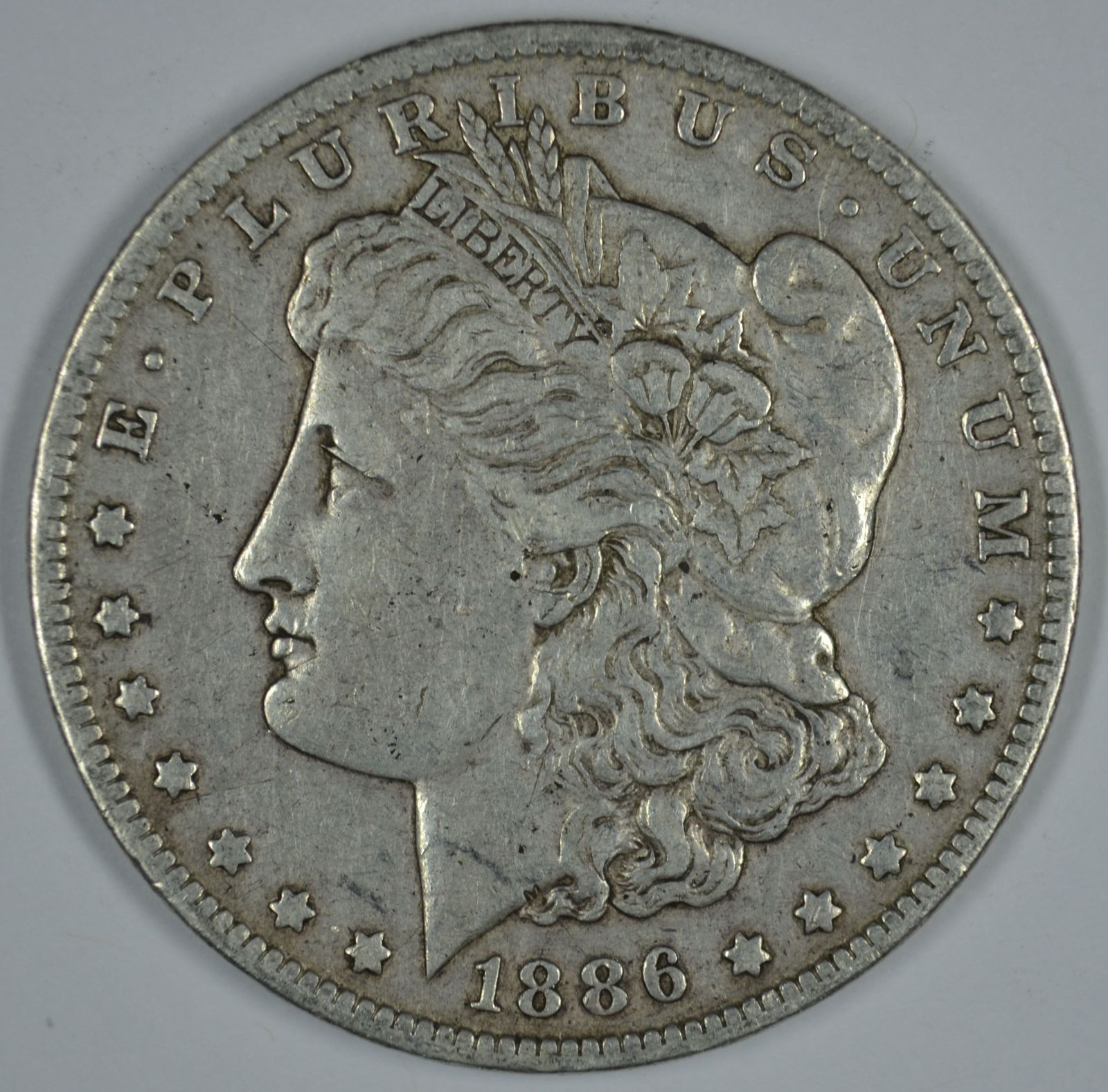 Primary image for 1886 O Morgan circulated silver dollar F details