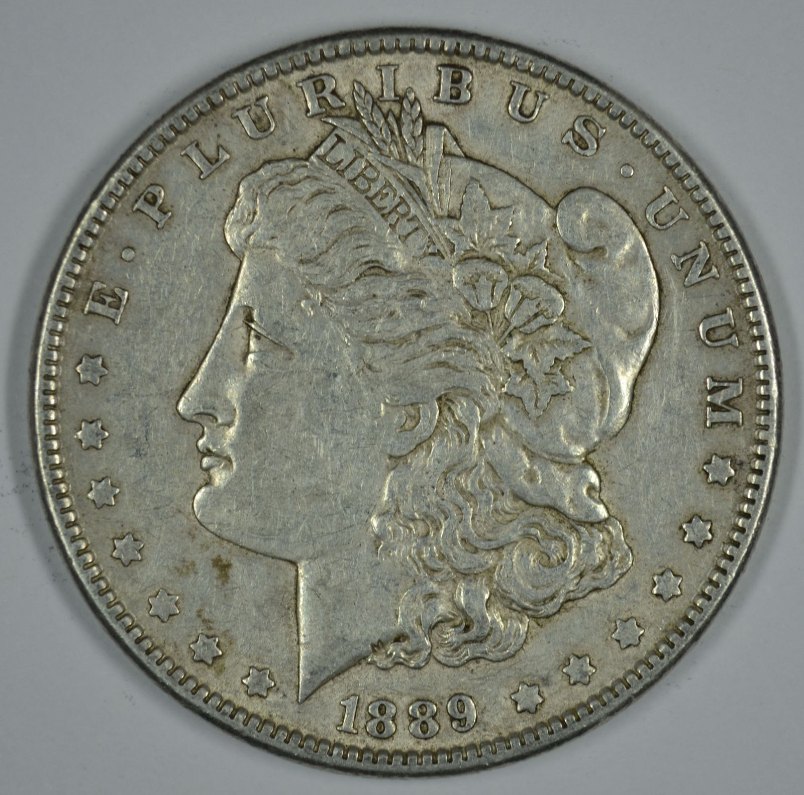 Primary image for 1889 P Morgan circulated silver dollar VF details