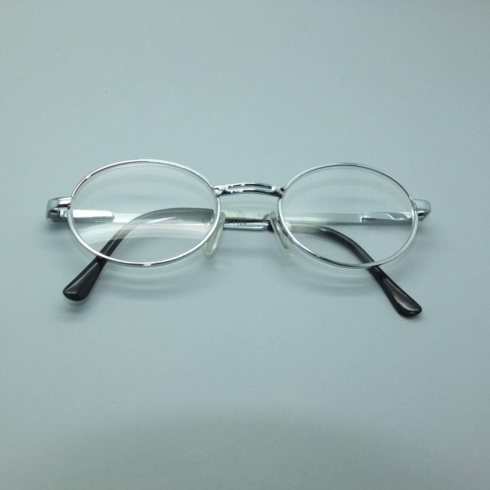 reading glasses silver metal pretty oval frame 1 25 lens