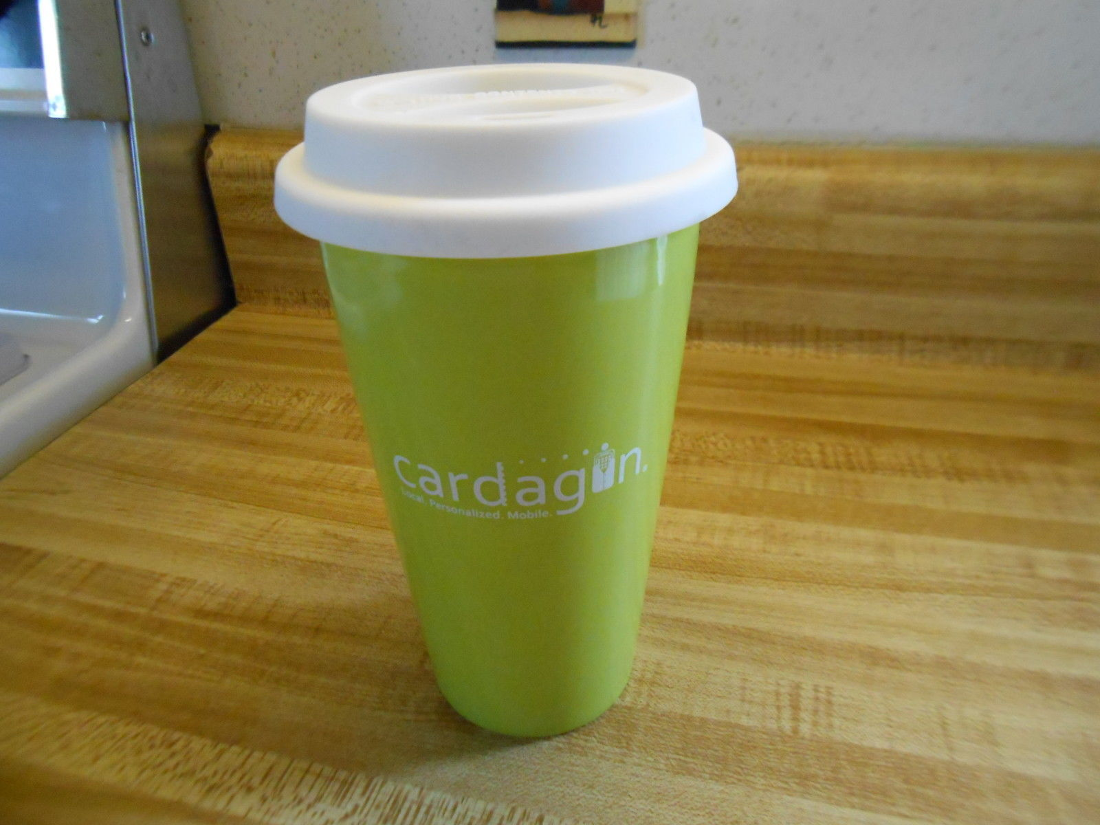 "Primary image for Travel mug ~ ceramic travel mug with flexible cover top says ""Cardagun"" on it"