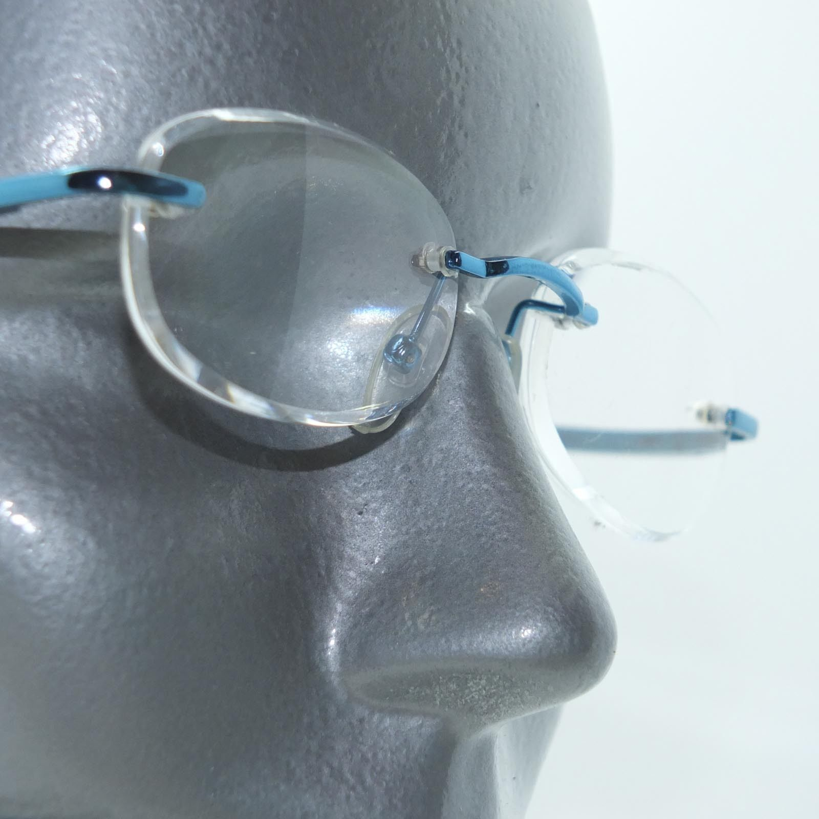 Primary image for Frameless Invisible Lens Electric Blue Trim Reading Glasses +2.75 Strength