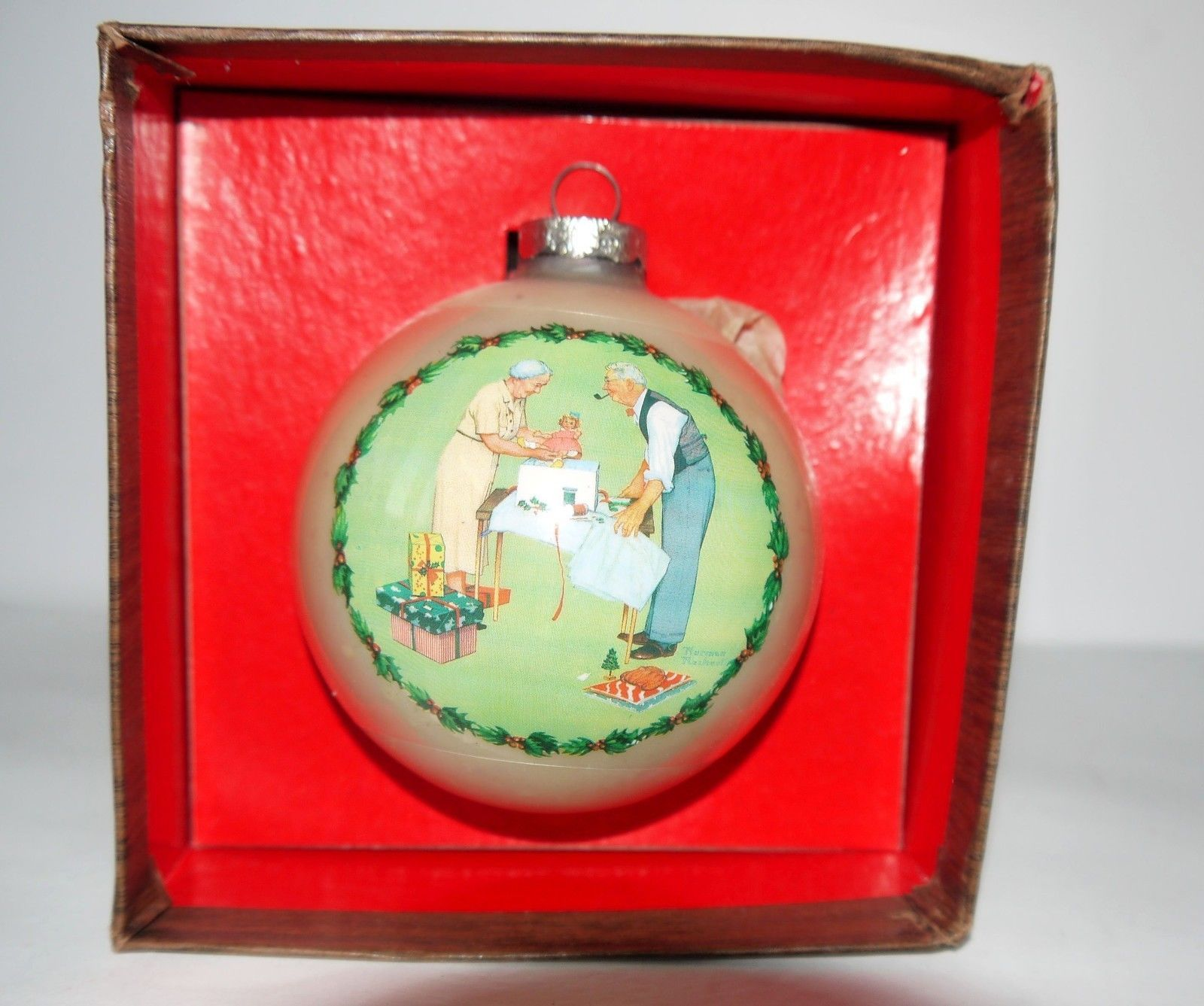 "Primary image for Vintage Norman Rockwell's 1979 ""Wrapping Christmas Presents"" Glass Ornament"