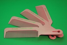 Andis comb color is pink and is 4 piece set - $12.20