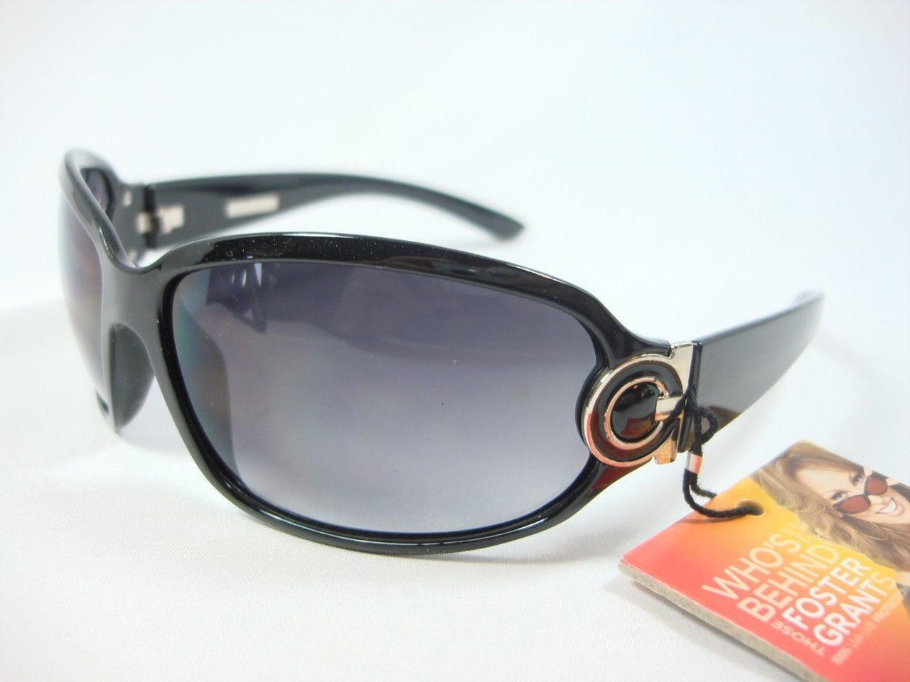 Primary image for FOSTER GRANT BLACK SUNGLASSES SIDE METAL DESIGN REMEMBRANCE OL1110