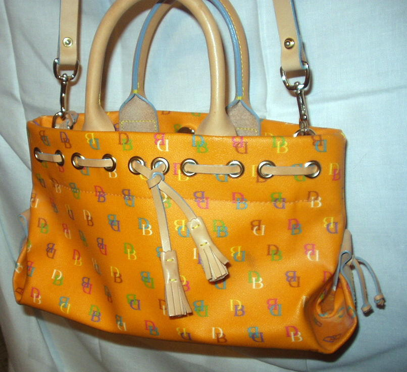 Primary image for Orange Leather Tassel Tote Satchel Dooney and Bourke D & B Handbag Excellent Con