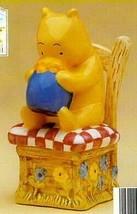 Winnie The Pooh Bear  in chair Salt & Pepper Disney - $32.49