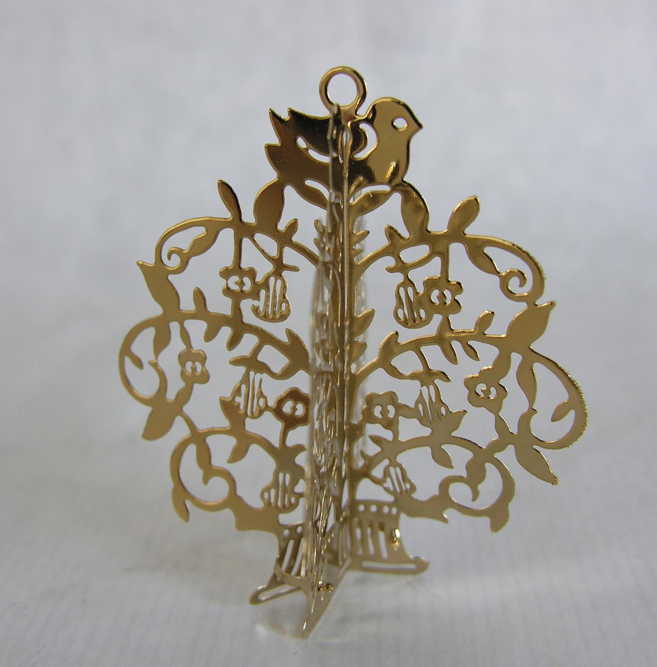 Golden christmas tree metal ornament vintage