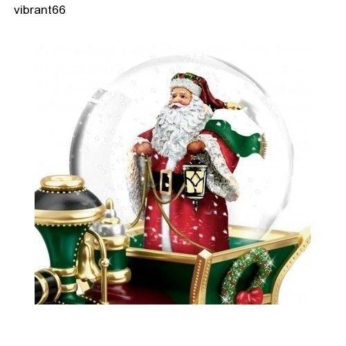 Christmas snow globe santa claus musical train