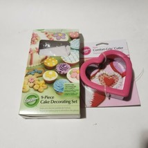 Wilton Heart-Shaped Large Comfort-Grip Cutter with 9 piece cake decorati... - $10.39