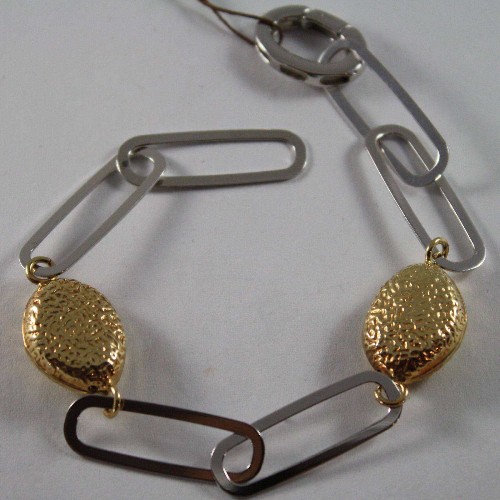 .925 RHODIUM SILVER AND YELLOW GOLD PLATED BRACELET WITH OVAL HAMMERED