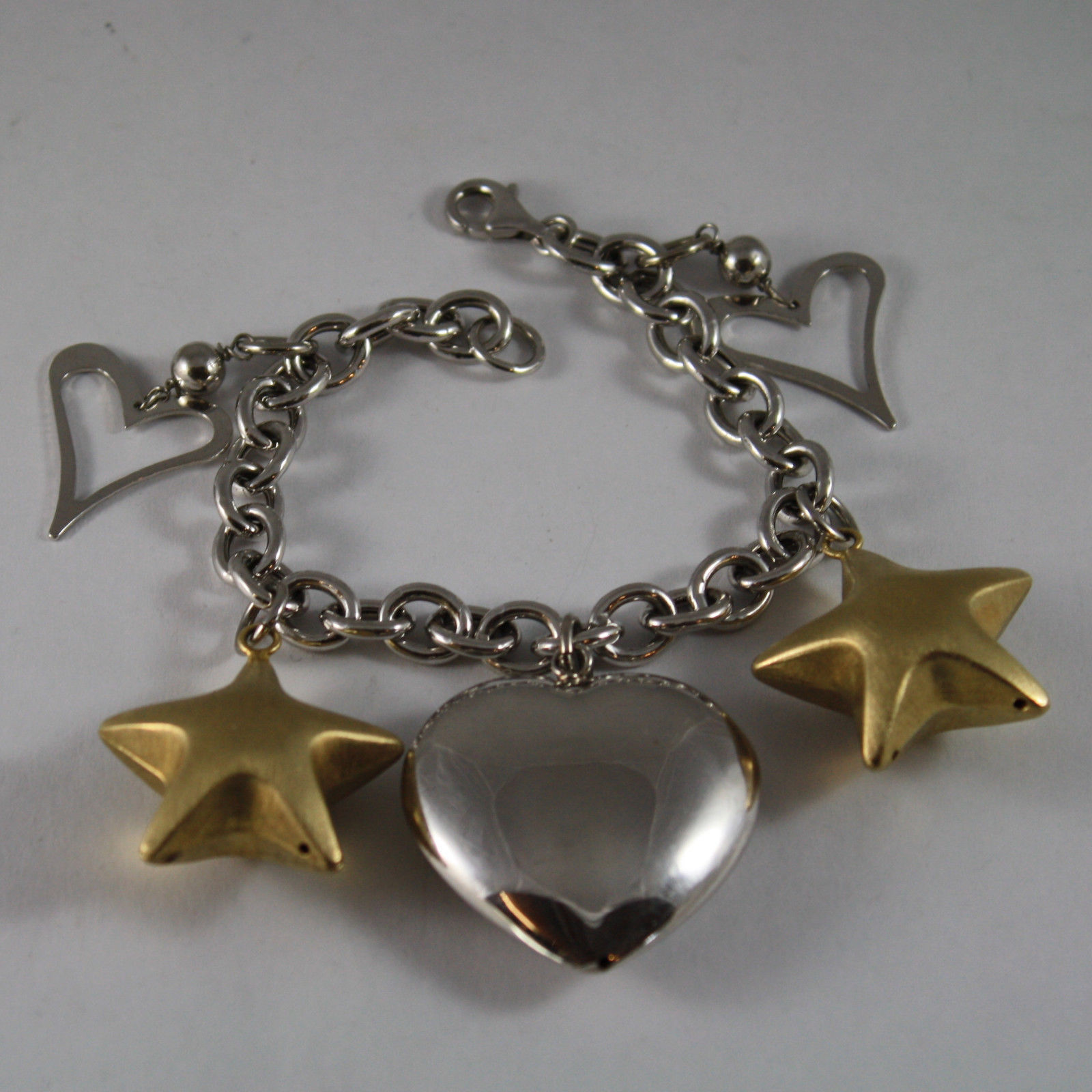 .925 RHODIUM SILVER BRACELET WITH YELLOW GOLD PLATED STARS AND HEARTS
