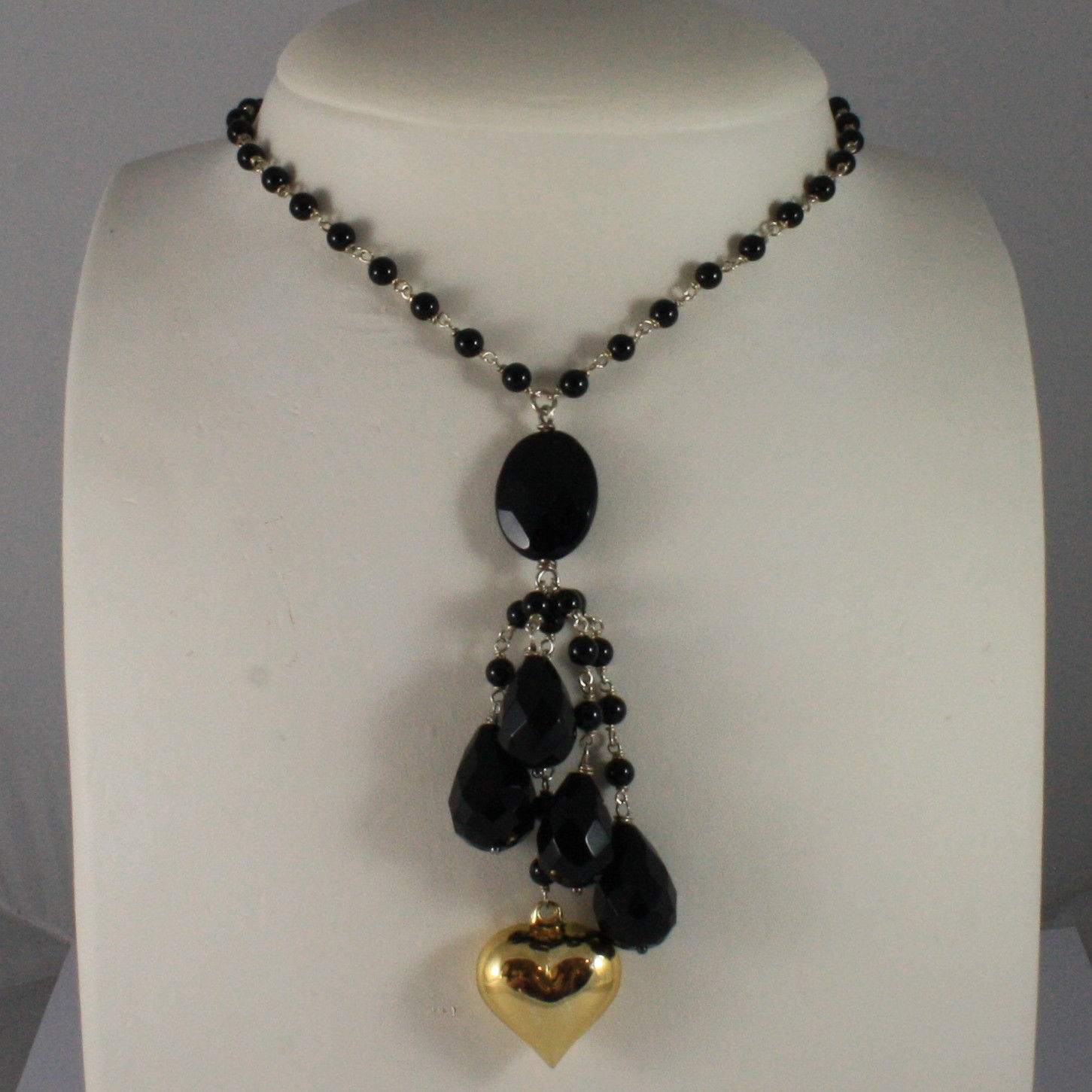 .925 SILVER RHODIUM NECKLACE WITH YELLOW GOLD PLATED HEART AND BLACK ONYX