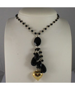 .925 SILVER RHODIUM NECKLACE WITH YELLOW GOLD PLATED HEART AND BLACK ONYX - $198.55