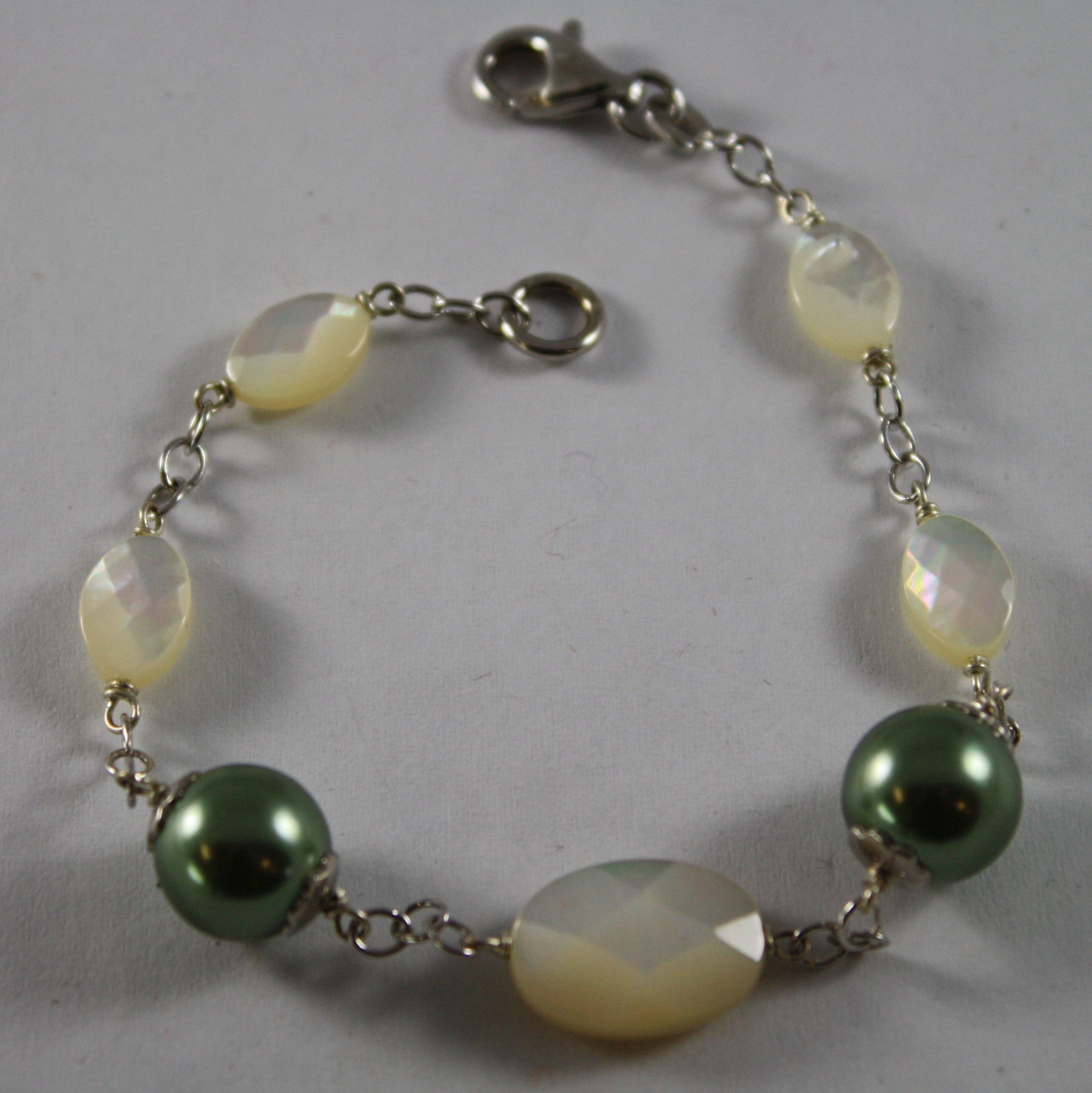 .925 RHODIUM SILVER BRACELET WITH OVAL MOTHER OF PEARL AND GREEN PEARLS REBUILT