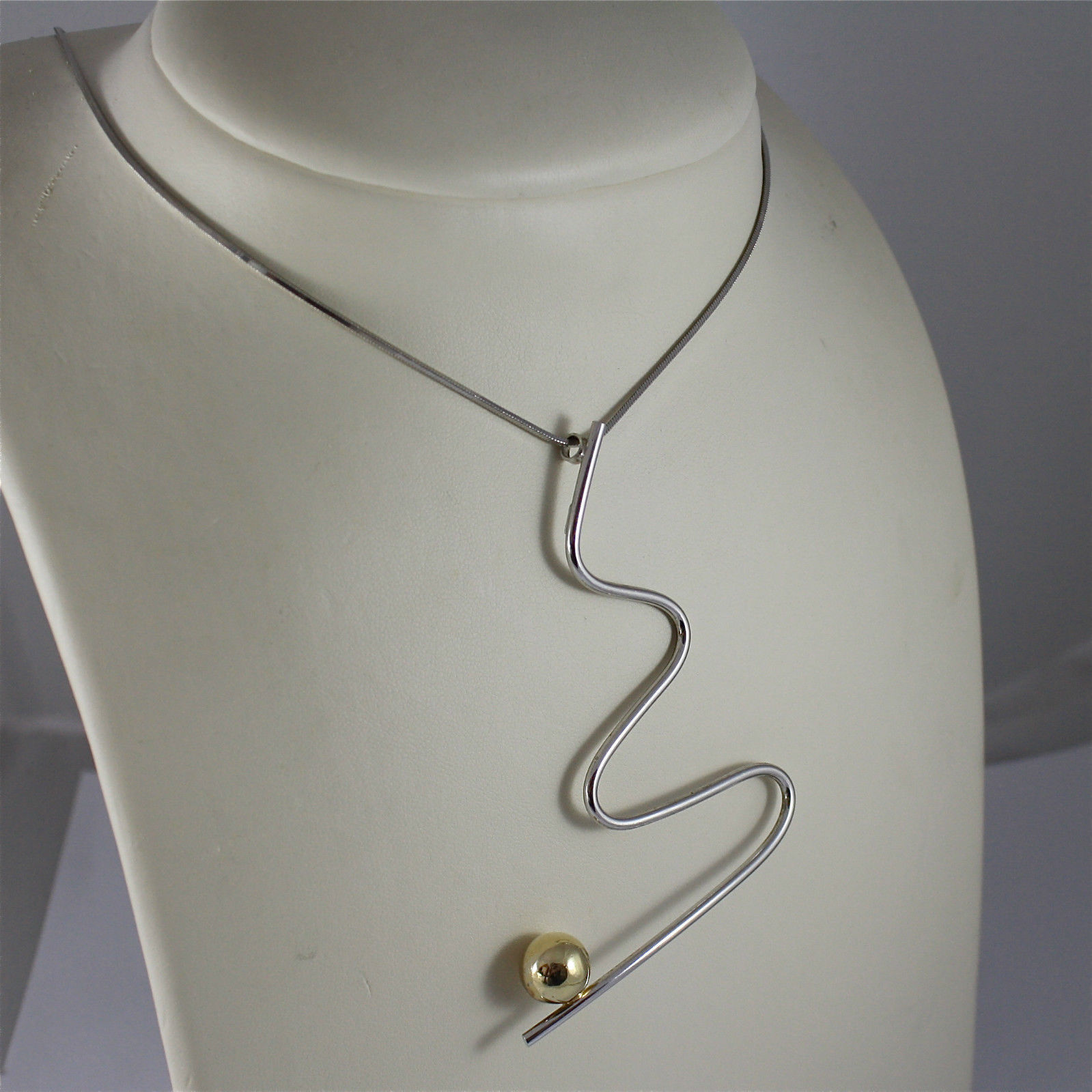 ".925 RHODIUM SILVER NECKLACE, CENTRAL ""WAVE"" WITH YELLOW GOLD PLATED BALL."