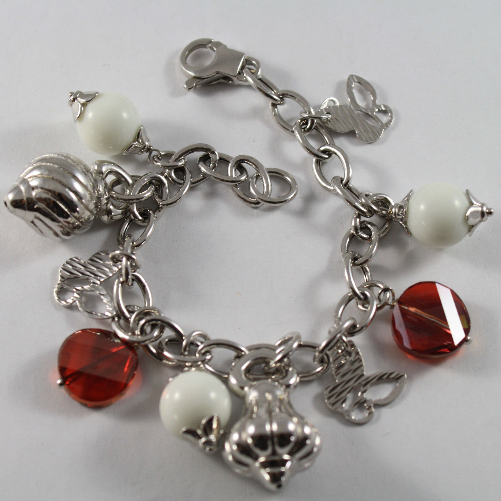 .925 RHODIUM SILVER BRACELET WITH ORANGE CRYSTAL, WHITE AGATE AND CHARMS