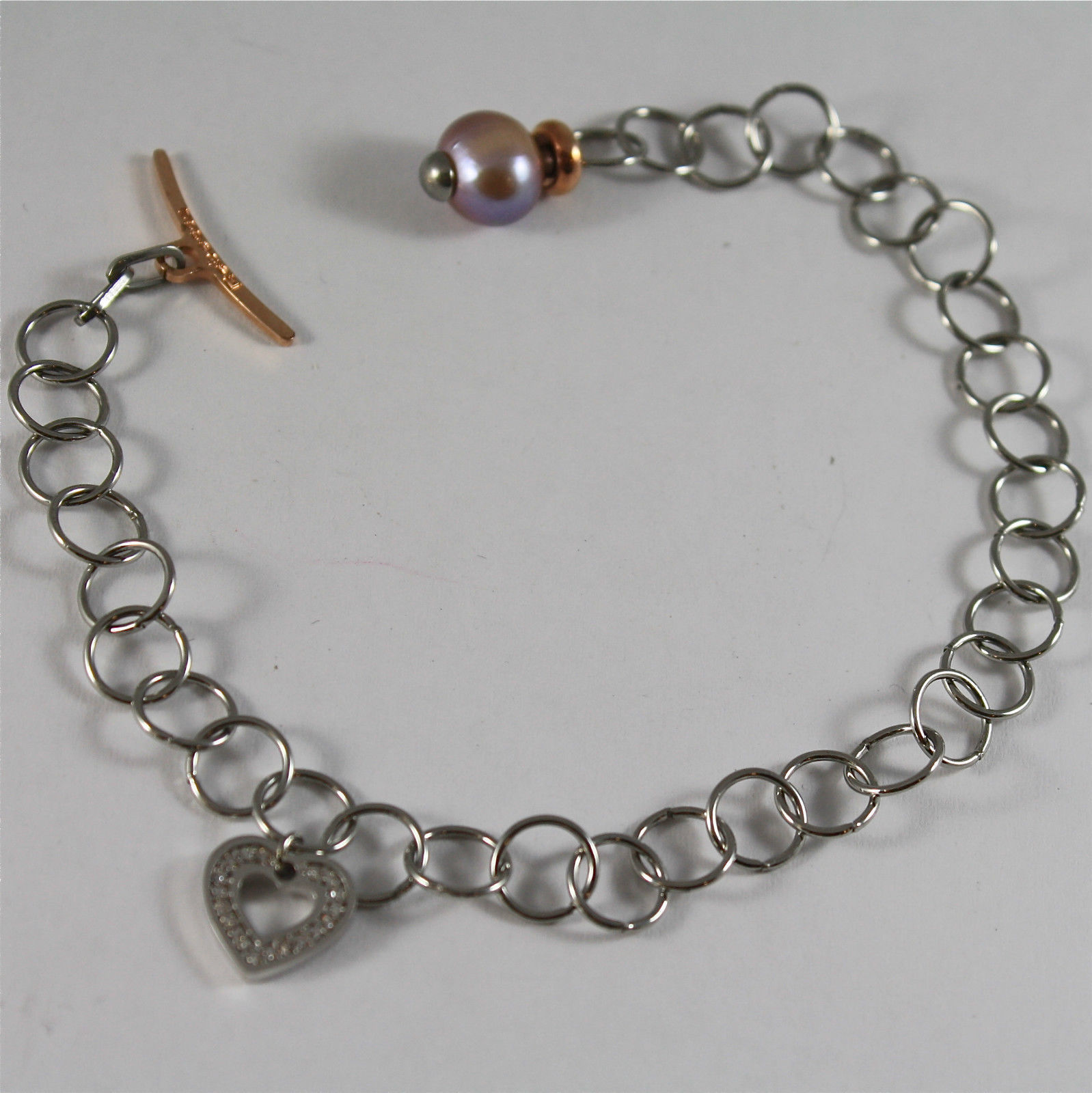 RHODIUM-PLATED BRONZE BRACELET WITH CHARMS AND PEARL, BY REBECCA MADE IN ITALY.