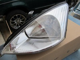 OEM Left Driver Side LH Ford Focus New Headlight Head Light 4 DR H/B 00 02 03 04 - $48.51