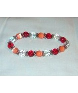 bracelet handmade in beautiful colors of red co... - $8.00