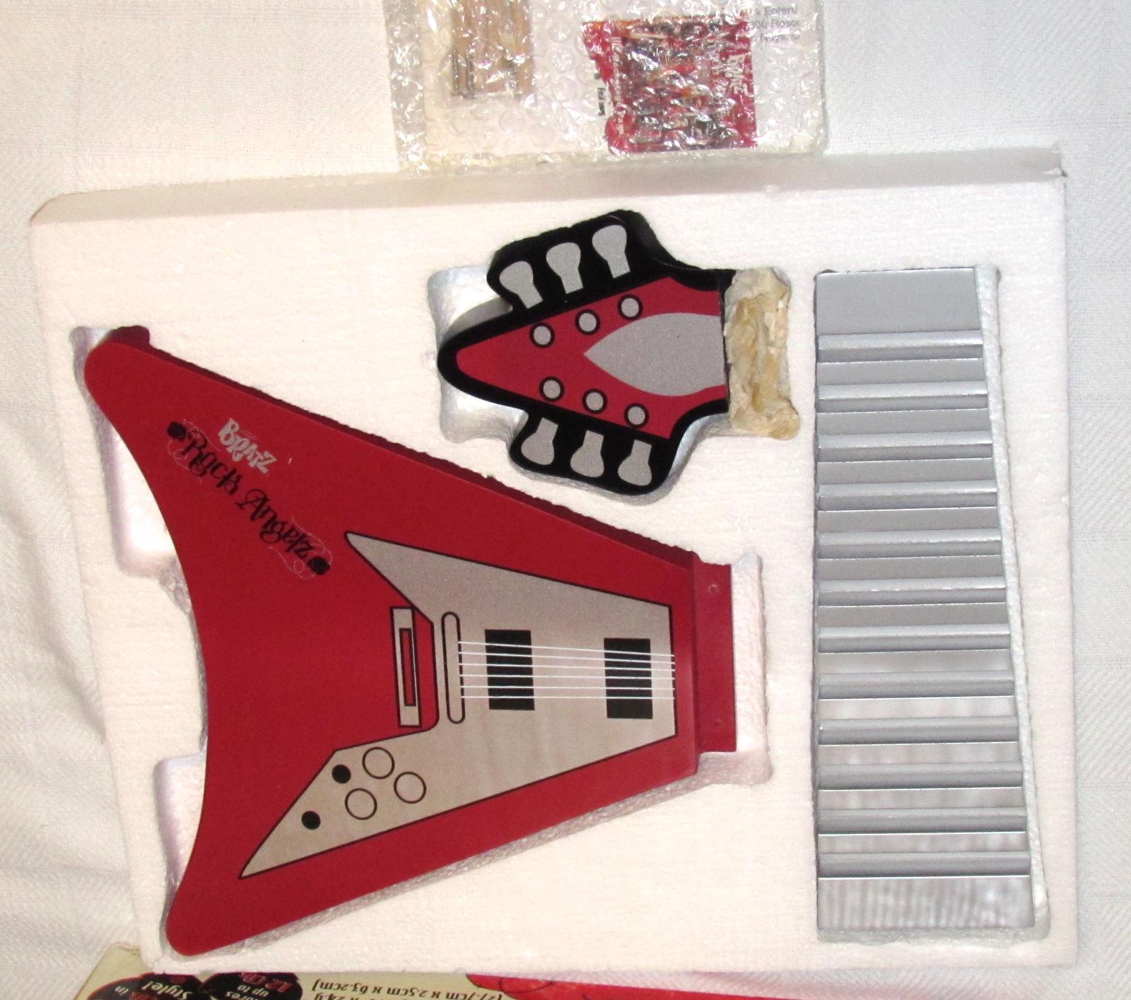 bratz rock angelz home decor collection guitar design tune tower cd rack cd video racks. Black Bedroom Furniture Sets. Home Design Ideas
