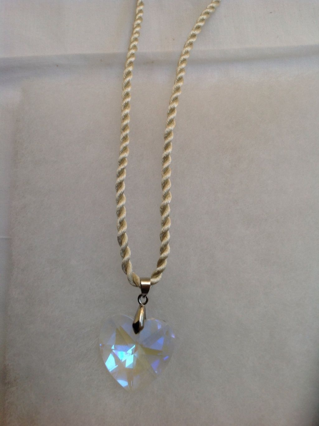 Swarovski heart 18KGP with free cord included.