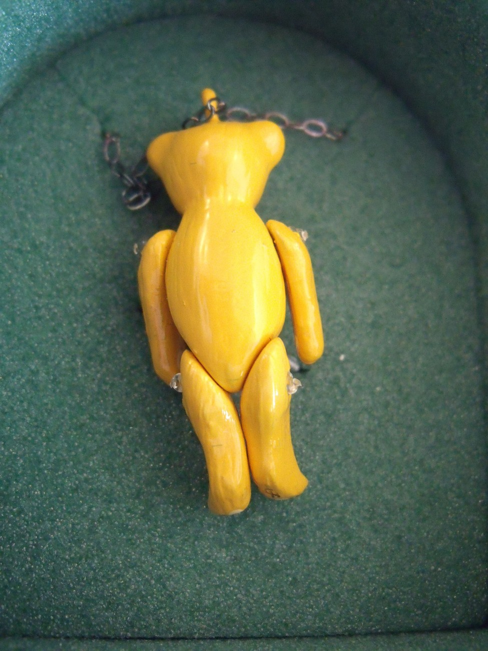 Minnie Maria Yellow pewter articulated bear necklace.