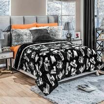 Grafito Black with White Reversible Lightweight Blanket by Intima Hogar - $54.40+