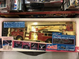 UNUSED TOYBOX FIRE ENGINE WITH 15 ACTIONS - $346.50
