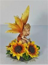 91652 Orange Winged Fairy Attending Sunflower by Backwoods Lighting LLC - $31.27