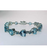 BLUE TOPAZ Large HEARTS Tennis BRACELET in STERLING Silver - 8 1/2 inches - $225.00
