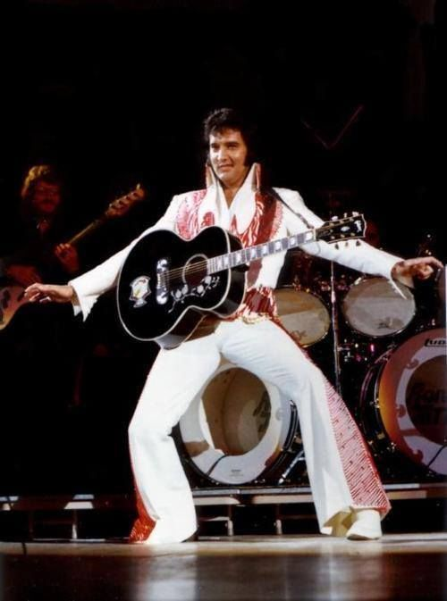 Elvis Presley on stage wearing his Red and 50 similar items