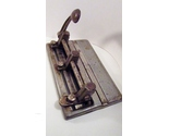 Steel_three-hole_punch_1950s_master_series_1000_made_in_usa_01_thumb155_crop