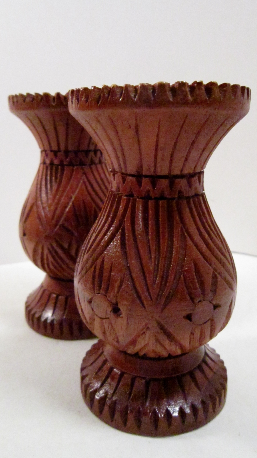 Set of carved wood candle holders for tapers 01