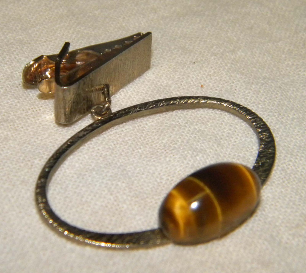 Vintage tie clasp 1/2 inch amber stone on silver colored oval ring