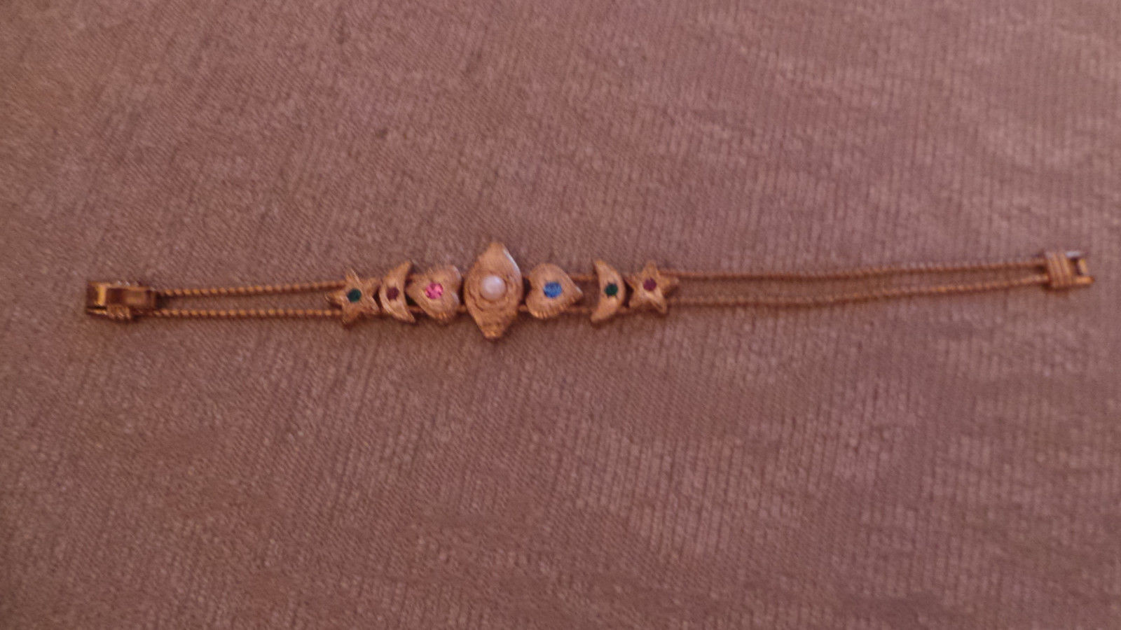 "Primary image for unique Gold tone bracelet w hearts, half moons, stars, pearl piece 7 1/4"" lg VG+"